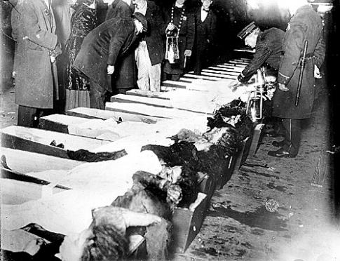 Victims of the Triangle waist shirt factory fire are lined up for inspection. 1911.